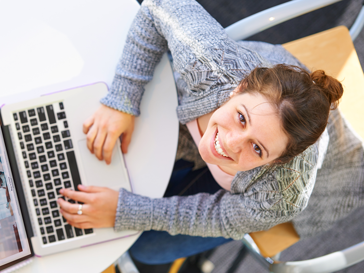 High angle portrait of a young woman using her laptop indoors